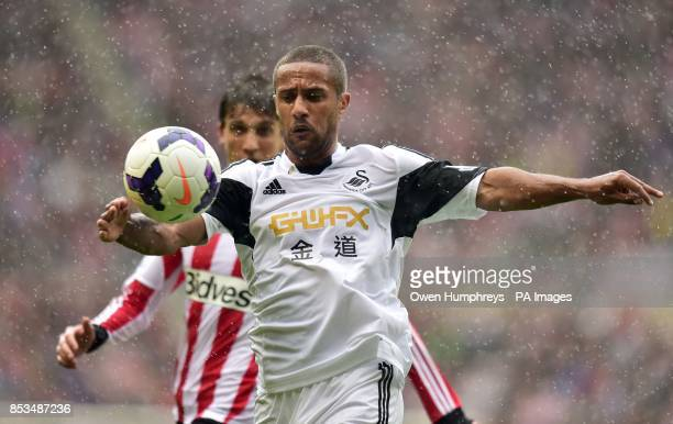 Swansea's Wayne Routledge and Sunderland's Santiago Vergini battle for the ball during the Barclays Premier League match at the Stadium of Light...
