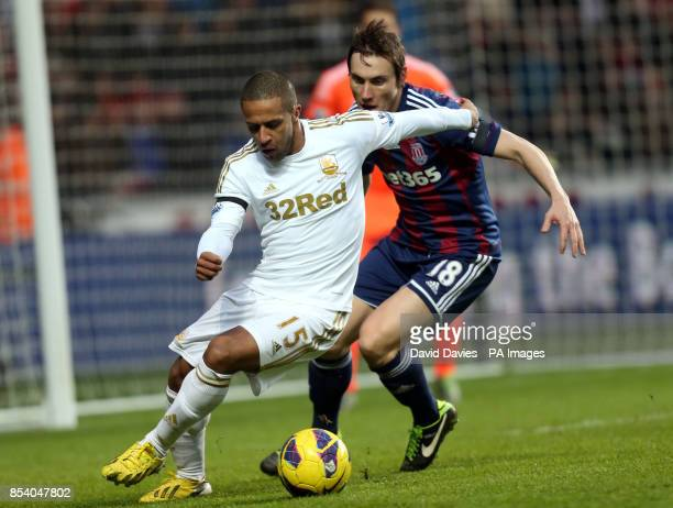 Swansea's Wayne Routledge under pressure from Stoke's Dean Whitehead during the Barclays Premier League match at the Liberty Stadium Swansea
