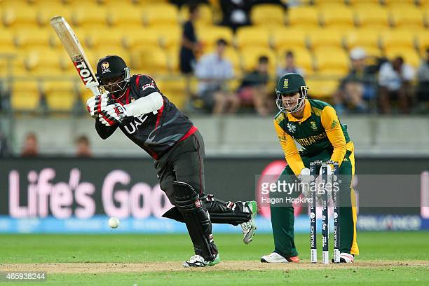 Swapnil Patil of the United Arab Emirates bats while Quinton de Kock of South Africa looks on during the 2015 ICC Cricket World Cup match between...