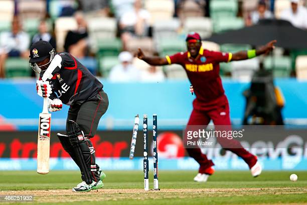 Swapnil Patil of the United Arab Emirates is bowled by Jason Holder of West Indies during the 2015 ICC Cricket World Cup match between the West...