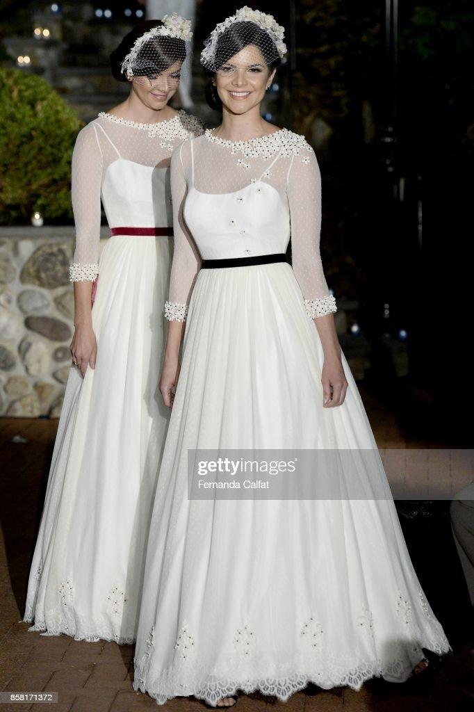 Swara Sampaio and Swanmy Sampaio walk the Po de Arroz runway show at New York Fashion Week Bridal October 2017 at Hendrick's Tavern on October 5, 2017 in Roslyn, New York.
