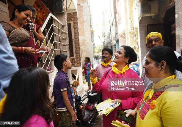Swaraj Party candidate Subha Sharma during the municipal election campaign at Khichripur on March 22 2017 in New Delhi India She has earlier worked...