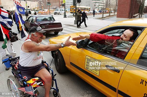 Swasi Turner gets a gladtoseeyou handshake from a cabbie at the end of his trek across America Turner a retired police officer took the journey to...