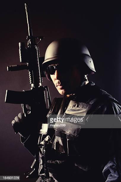 Swat team member posing with a gun