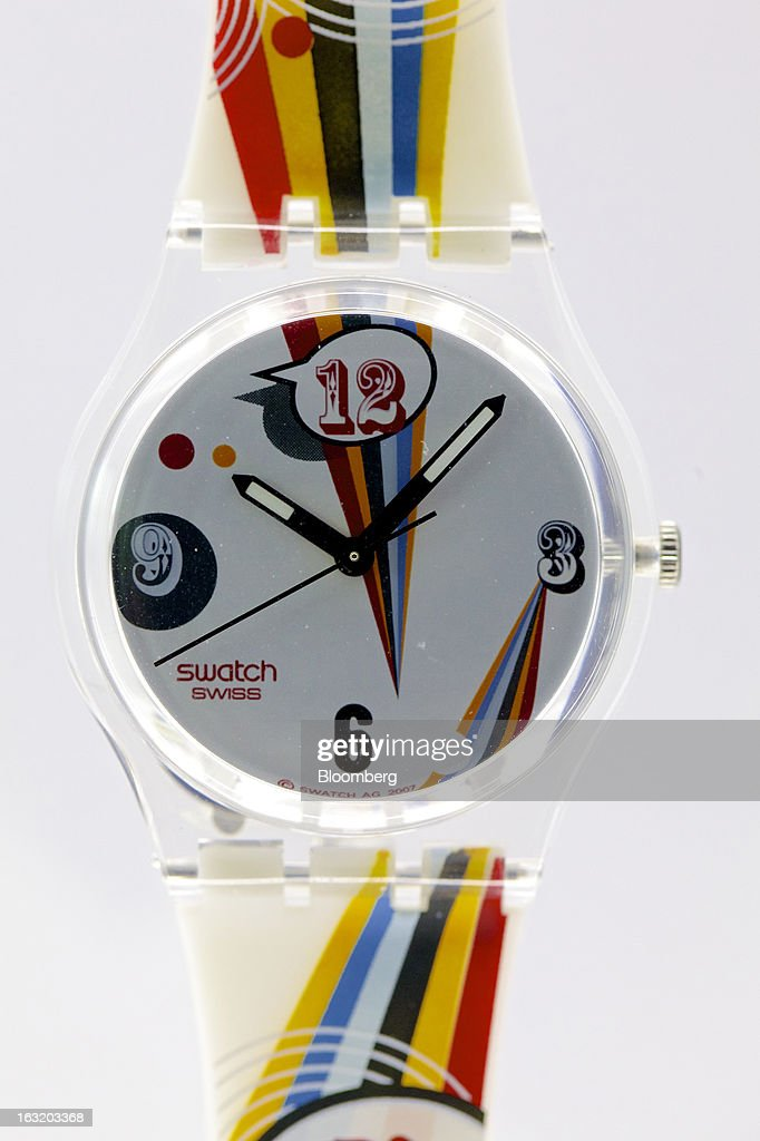 A Swatch GE198 'Crazy Youngster' wristwatch, produced by Swatch Group AG, sits on display following the company's annual results news conference in Grenchen, Switzerland, on Wednesday, March 6, 2013. Swatch Group AG, the biggest maker of Swiss timepieces, fell as much as 3.1 percent in Zurich trading after Hayek sought to downplay expectations over industry growth prospects. Photographer: Gianluca Colla/Bloomberg via Getty Images