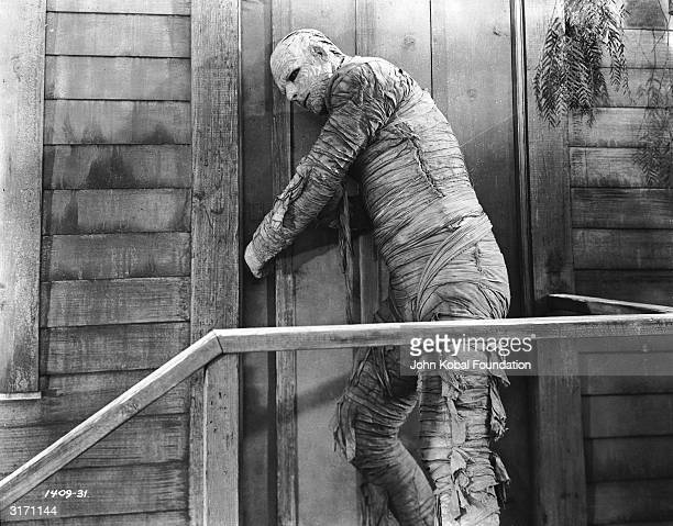 Swathed in bandages and leaning against a door Lon Chaney Jnr as the Kharis in 'The Mummy's Curse' Directed by Leslie Goodwins for Universal