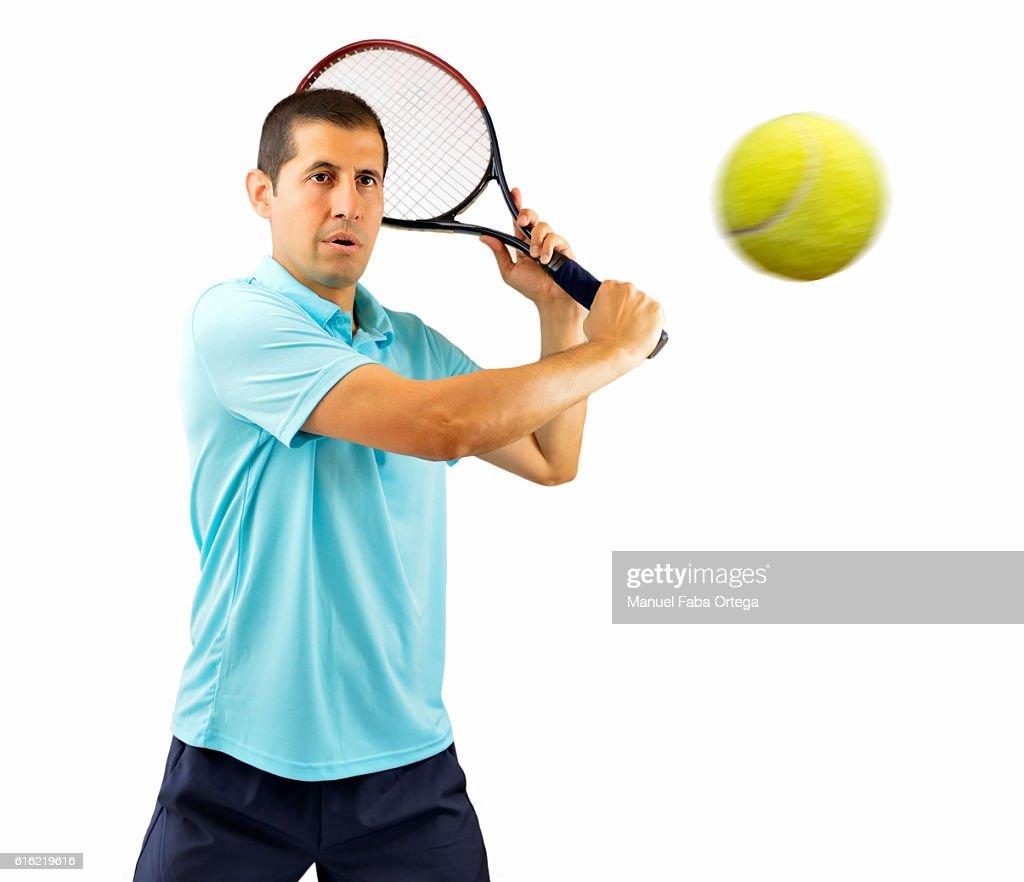 swatting this tennis ball : Stock Photo