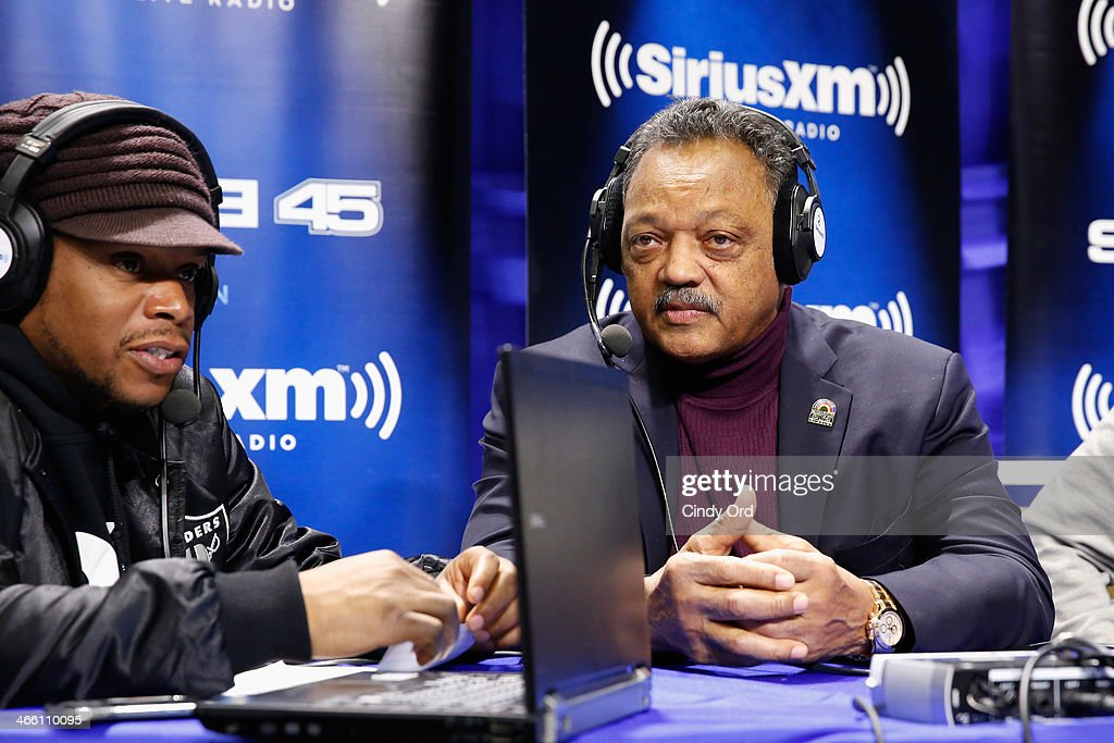 Sway Calloway of SHade 45 (L) and Jesse Jackson attend SiriusXM At Super Bowl XLVIII Radio Row on January 31, 2014 in New York City.