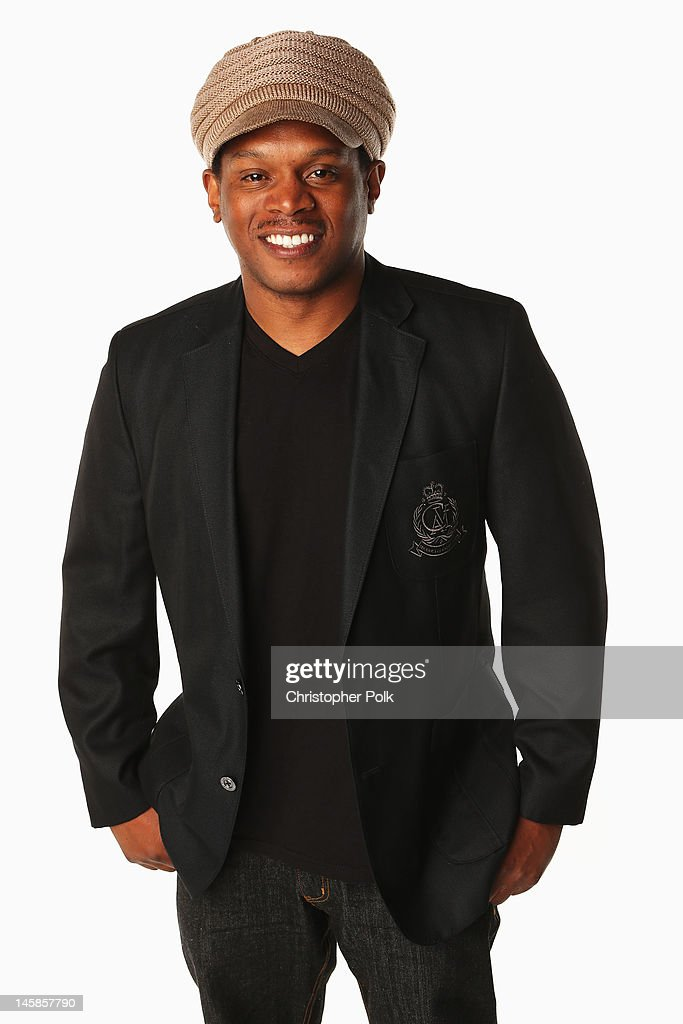 Sway poses in the Wonderwall.com.com Portrait Studio during 2012 CMT Music awards at the Bridgestone Arena on June 6, 2012 in Nashville, Tennessee.