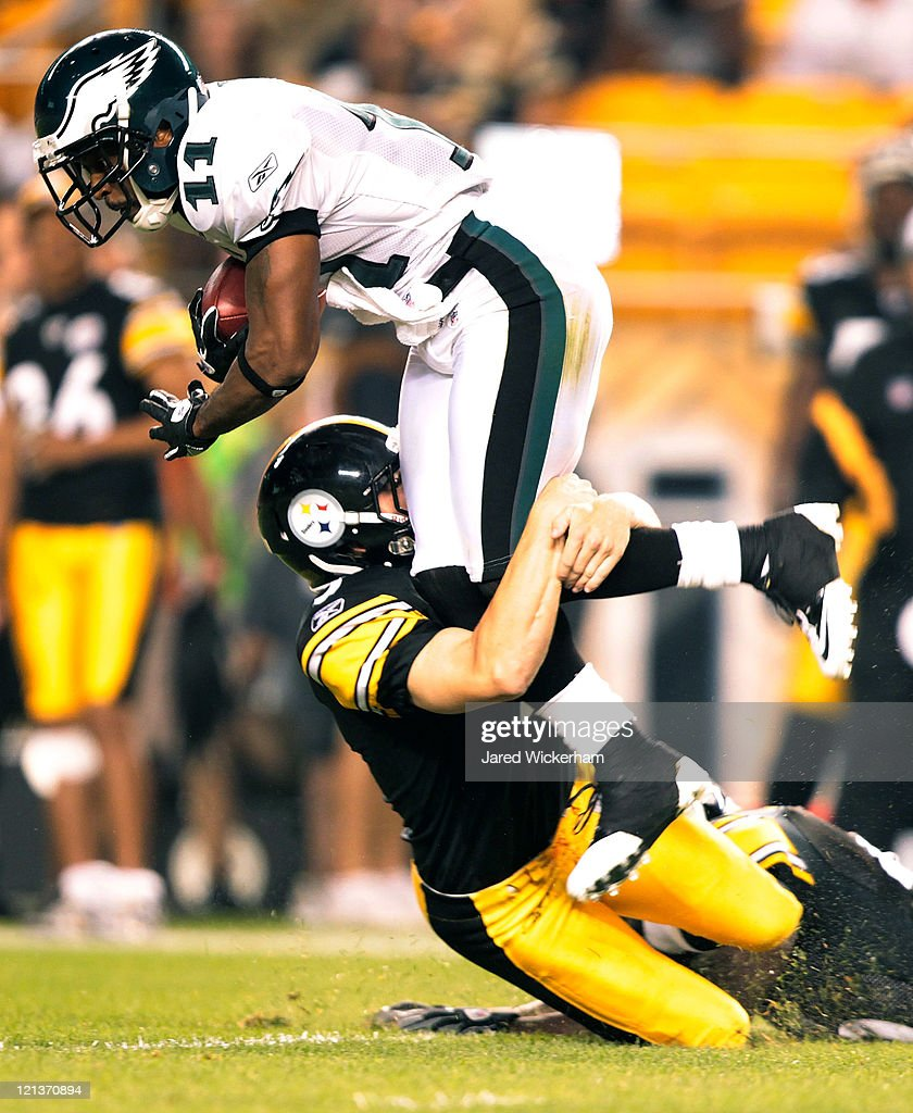 Swayze Waters #5 of the Pittsburgh Steelers tackles Sinorice Moss #11 of the Philadelphia Eagles on a kickoff return during the preseason game on August 18, 2011 at Heinz Field in Pittsburgh, Pennsylvania.