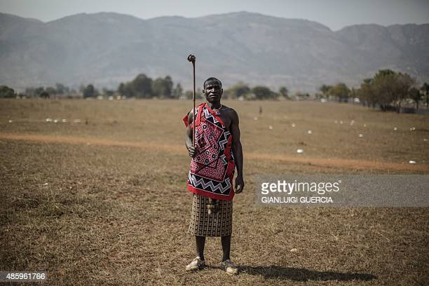 A Swazi Indvuna who supervises regiments of Maidens poses during the first day of the annual royal reed dance at the Ludzidzini Royal palace on...