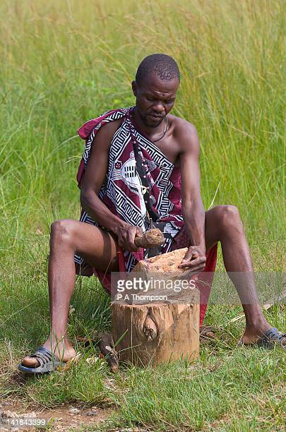 Swazi man carving wooden bowl, Swaziland