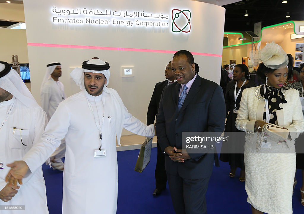 Swaziland's King Mswati III and his wife Inkhosikati LaMbikiza (R) listen to an explanation by an exhibitor during their tour to WEF Exhibition during the opening the World Energy Forum 2012 in Dubai's Exhibition Centre, on October 22, 2012.