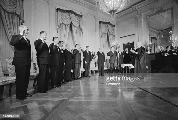 Swears In New Cabinet Washington DC Chief Justice Earl Warren swears in new Kennedy Cabinet in White House ceremony January 21st Left to right are...