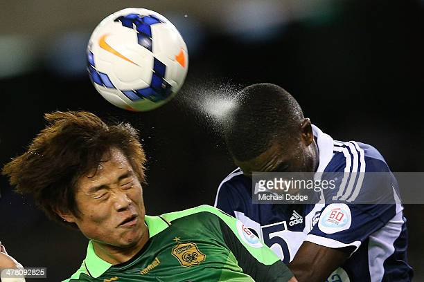 Sweat sprays off the head of Jason Geria of the Victory as heads the ball away from Choi Bokyoung of Joenbuk during the AFC Asian Champions League...