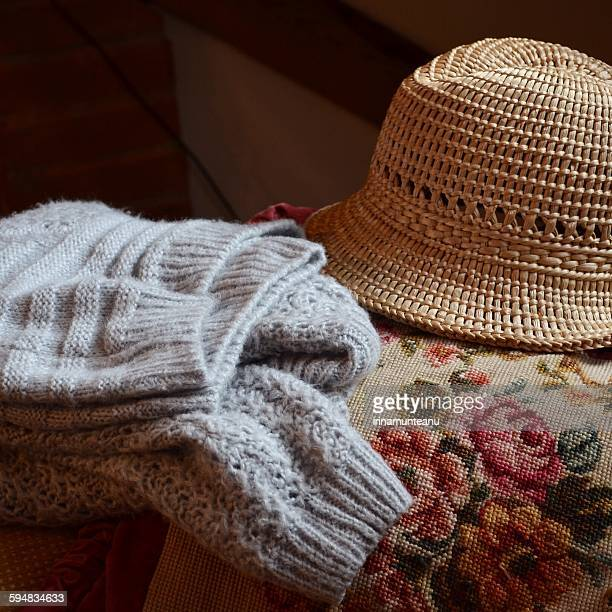 Sweater and a hat on a couch