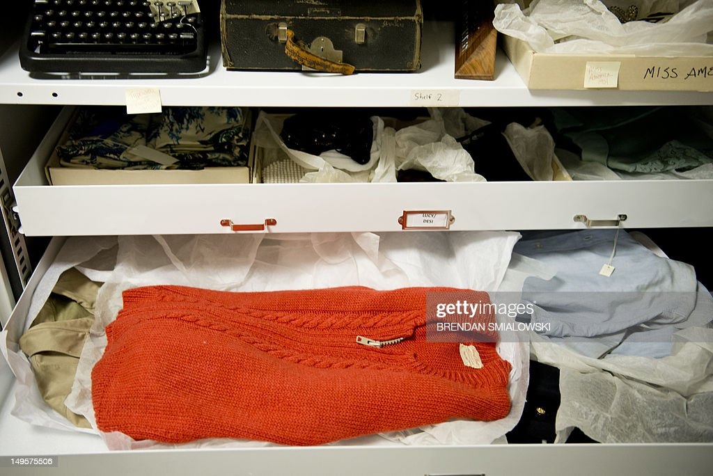 A sweater knit by his mother and once belonging to Fred Rogers, star of PBS show 'Mister Rogers' Neighborhood', is seen among other items in the vaults at the Smithsonian's American History Museum July 27, 2012 in Washington, DC. The sweater and other items are stored onsite at the American History Museum on the National Mall with other objects of significance that are not on display. AFP PHOTO/Brendan SMIALOWSKI