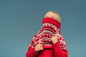 Little girl dresses a red pullover