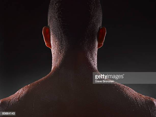 Sweaty back of athletic black man