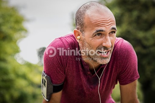 Sweaty mature jogger : Stock Photo