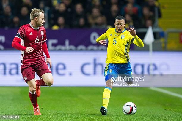 Sweden 5 Martin Olsson takes on Denmark 6 Lars Jacobsen durring a European Qualifier PlayOff between Sweden and Denmark on November 14 2015 in Solna...