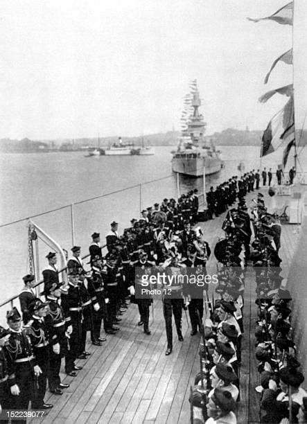 Sweden A French squadron in Stockholm King Gustav V of Sweden inspecting the troops of battlecruiser Duquesnes which are presented to him by admiral...