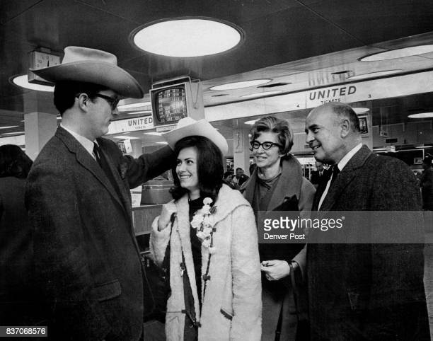 Sweden Bound Linda Ullstrom Colorado's 1967 'Lucia' receives a western hat as she prepares to leave for a week in Stockholm Sweden Presenting her...