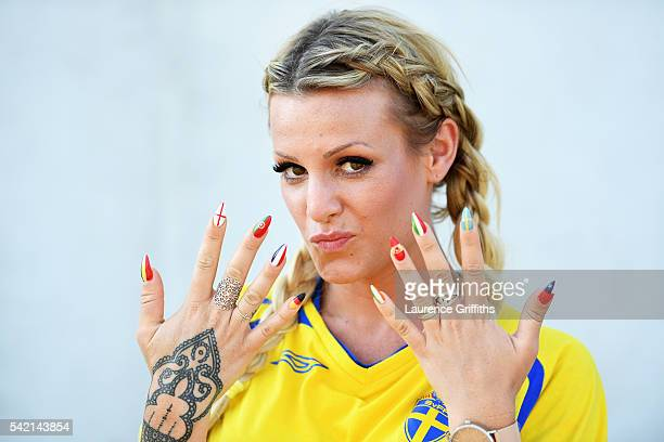 Sweden fan with nails painted in the falgs of different nations enjoys the build up to the UEFA EURO 2016 Group E match between Sweden and Belgium at...