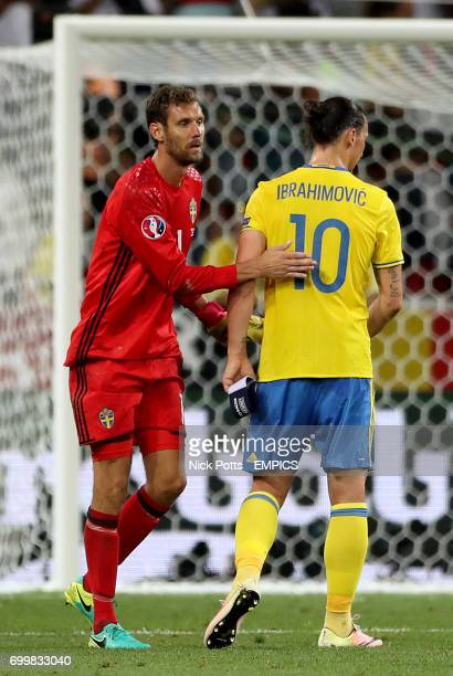 Sweden goalkeeper Andreas Isaksson with Sweden's Zlatan Ibrahimovic after the final whistle