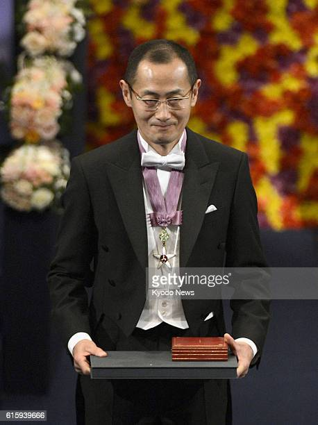 STOCKHOLM Sweden Japanese stem cell researcher Shinya Yamanaka a corecipient of the 2012 Nobel Prize in medicine is applauded after receiving his...