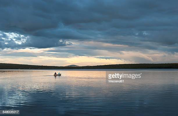 Sweden, Lapland, Norrbotten County, Kiruna, canoeing father and son
