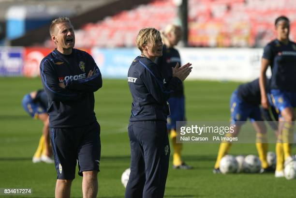 Sweden manager Thomas Dennerby and assistant manager Lilie Persson