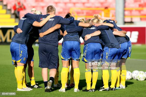 Sweden manager Thomas Dennerby huddles with the Sweden team prior to kick off