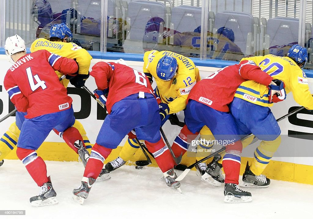 Sweden players and Norway players battle the puck during the 2014 IIHF World Championship between Sweden and Norway at Chizhovka arena on May 13, 2014 in Minsk, Belarus.