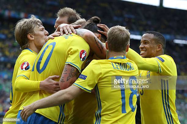 TOPSHOT Sweden players celebrate a goal during the Euro 2016 group E football match between Ireland and Sweden at the Stade de France stadium in...