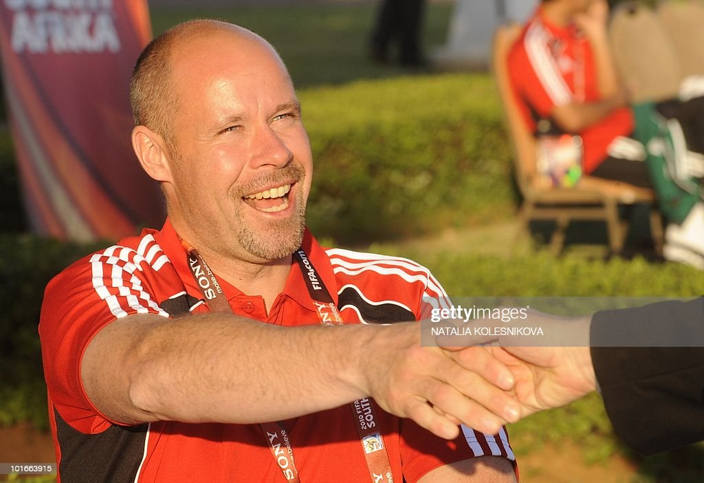 Sweden referee Martin Hansson shakes the hand of an unidentified person during an open media day on June 6, 2010 in Pretoria ahead of the 2010 football World Cup tournament.