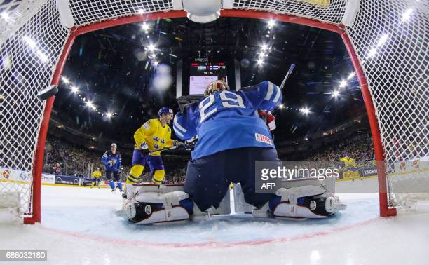 Sweden score their second goal during the IIHF Men's World Championship Ice Hockey semifinal match between Sweden and Finland in Cologne western...