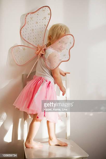 Sweden, Skane, girl (4-5) wearing fairy costume