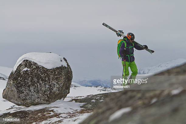 Sweden, Skier walking uphill