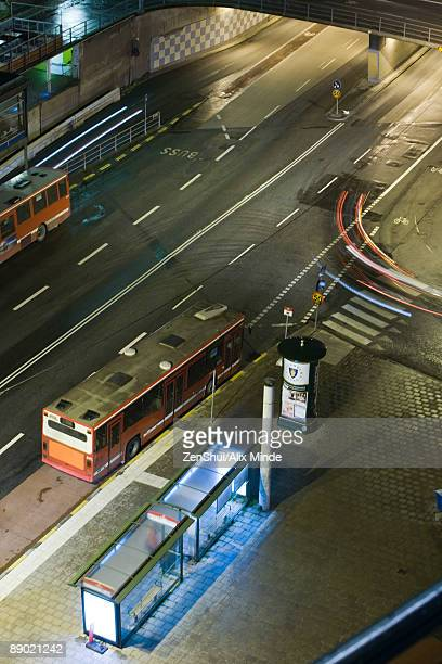 Sweden, Stockholm, bus waiting by bus stop at night, high angle view