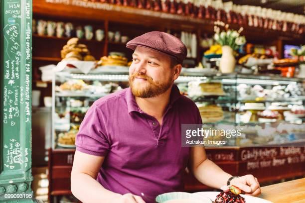 Sweden, Stockholm, Gamla Stan, Man having dessert in cafe