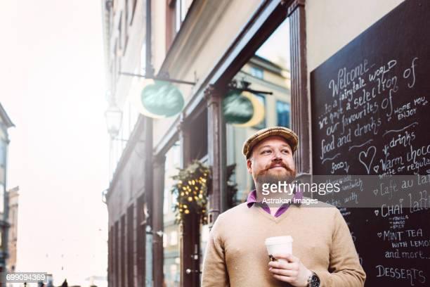 Sweden, Stockholm, Gamla Stan, Man standing in front of cafe