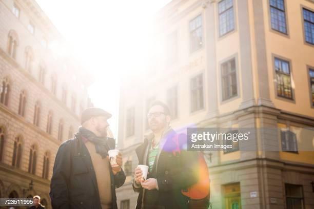 Sweden, Stockholm, Gamla Stan, Two men having coffee outdoors
