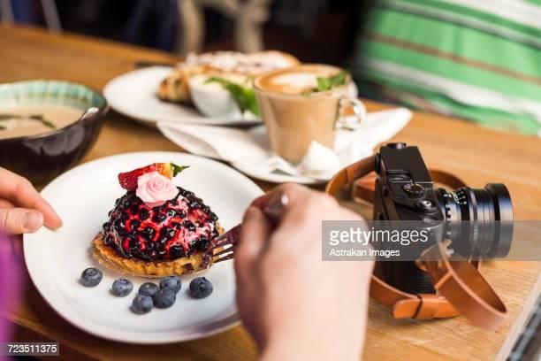 Sweden, Stockholm, Gamla Stan, Two men having dessert and coffee