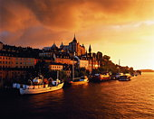 Sweden, Stockholm, Sodermalm, Lake Malaren, boats and town hall,sunset