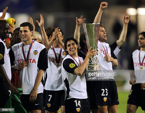 Valencia's Spanish midfielder Rogriguez Vicente holds up the trophy after beating Marseille 20 in the final of the UEFA cup football match at the...