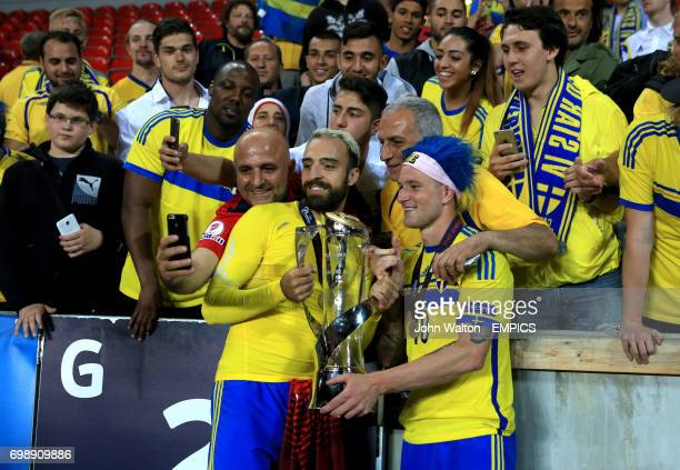 Sweden's Abdul Khalili and John Guidetti celebrate with the UEFA European Under21 Championship trophy in front of the fans