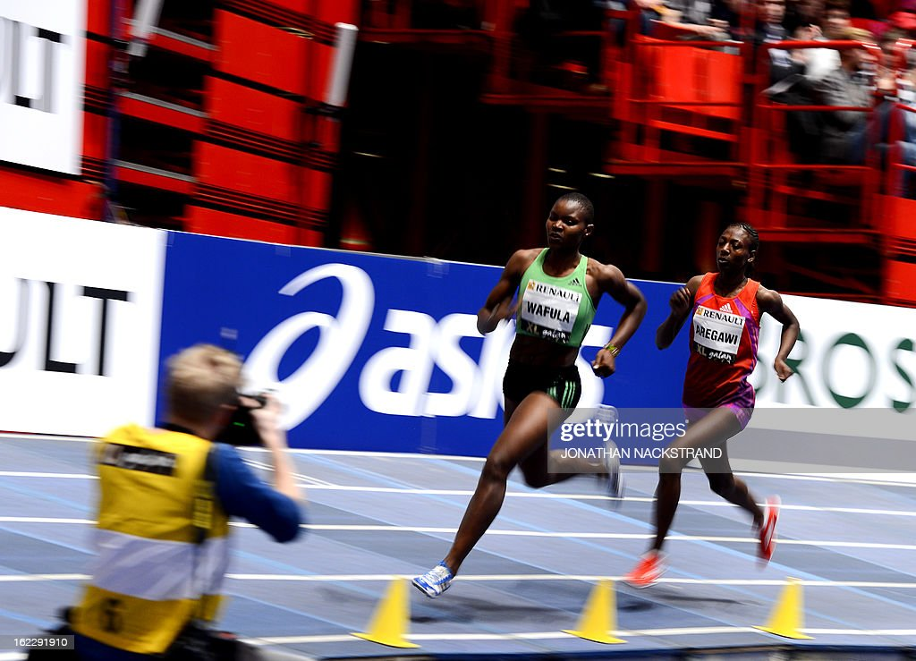 Sweden's Abeba Aregawi (R) and Kenya's Lydia Wafula compete in the women's 1500m event during the XL Galan Stockholm Indoor Athletics meeting on February 21, 2013 at the Ericsson Globe Arena in Stockholm.