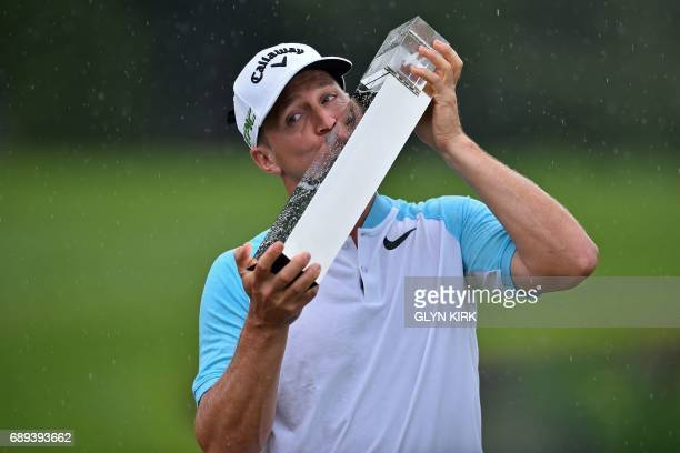Sweden's Alex Noren kisses the trophy after winning the PGA Championship at Wentworth Golf Club in the town of Virginia Water in Surrey southwest of...