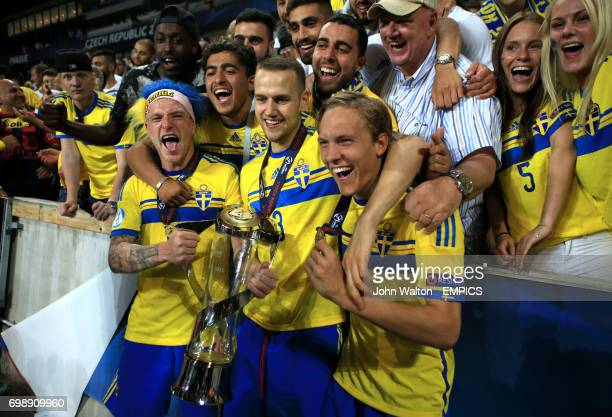 Sweden's Alexander Milosevic and John Guidetti celebrate with the UEFA European Under21 Championship trophy in front of the fans